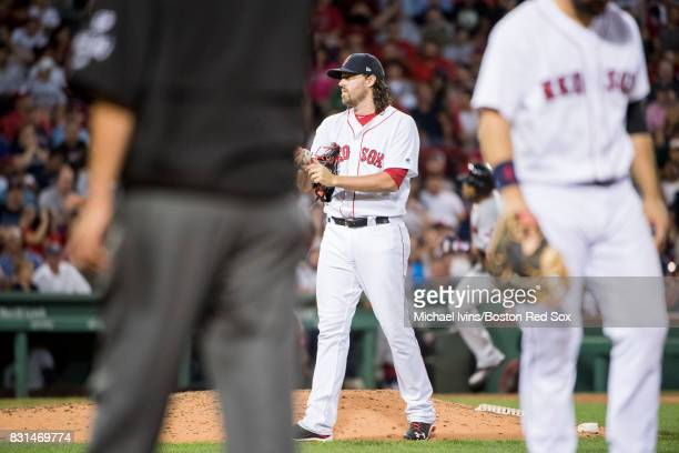 Heath Hembree of the Boston Red Sox walks off the mound after giving up a tworun home run to Edwin Encarnacion of the Cleveland Indians in the sixth...
