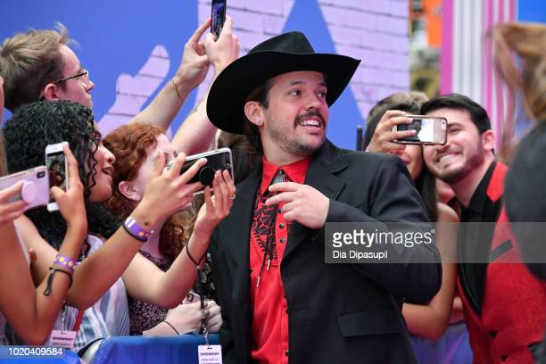 Heath Hussar and Zane Hijazi pose with fans at the 2018 MTV Video Music Awards at Radio City Music Hall on August 20 2018 in New York City