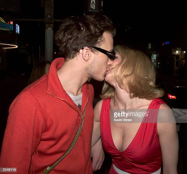 Heath Ledger and Heather Graham kiss at the premiere of 'Say It Isn't So' at the Village Theater in Los Angeles Ca 3/12/01 Photo by Kevin...