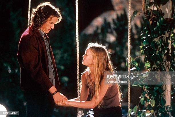 Heath Ledger and Julia Stiles at swing in a scene from the film '10 Things I Hate About You' 1999