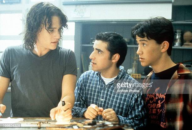 Heath Ledger, David Krumholtz, and Joseph Gordon-Levitt standing at table in a scene from the film '10 Things I Hate About You', 1999. (Photo by...