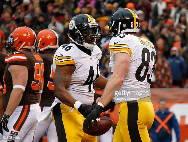 Heath Miller celebrates his touchdown with Will Johnson of the Pittsburgh Steelers during the first quarter against the Cleveland Browns at...