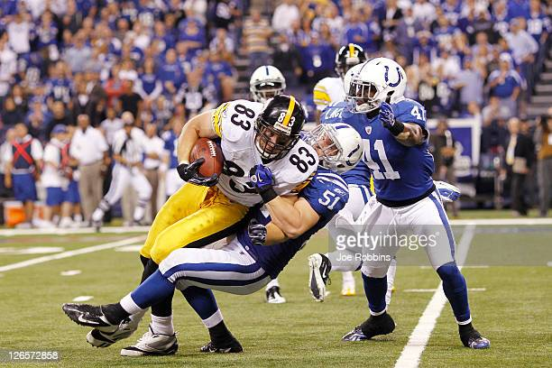 Heath Miller of the Pittsburgh Steelers gets tackled after making a reception by Pat Angerer of the Indianapolis Colts at Lucas Oil Stadium on...