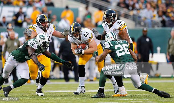 Heath Miller of the Pittsburgh Steelers in action against Dawan Landry and Demario Davis of the New York Jets on November 9 2014 at MetLife Stadium...