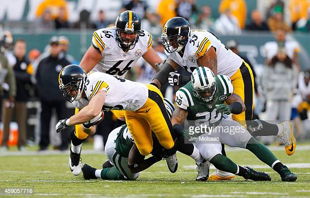 Heath Miller of the Pittsburgh Steelers in action against Dawan Landry of the New York Jets on November 9 2014 at MetLife Stadium in East Rutherford...