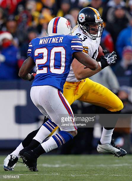 Heath Miller of the Pittsburgh Steelers is tackled by Donte Whitner of the Buffalo Bills during the game on November 28 2010 at Ralph Wilson Stadium...