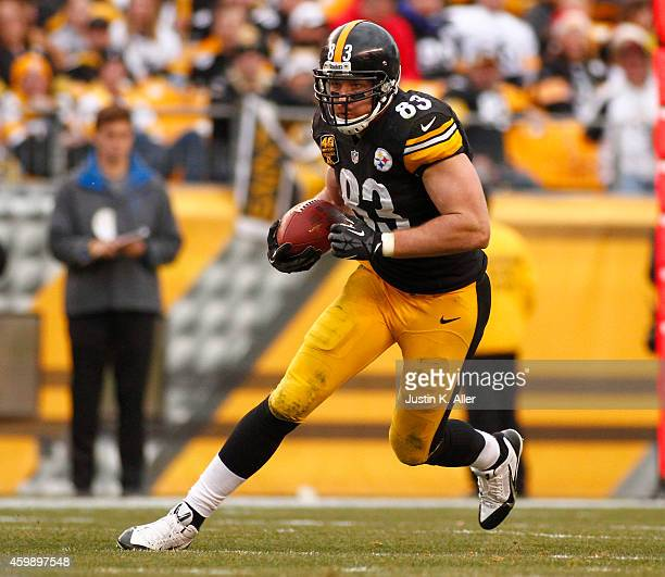 Heath Miller of the Pittsburgh Steelers runs after making a catch against the New Orleans Saints during the game on November 30 2014 at Heinz Field...