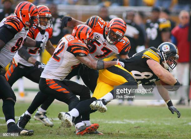 Heath Miller of the Pittsburgh Steelers tries to escape the tackle of Chris Crocker and Dhani Jones of the Cincinnati Bengals at Heinz Field on...