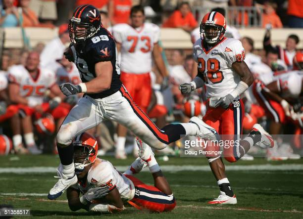Heath Miller of the Virginia Cavaliers makes a 54yard reception and is tackled by DeAndre LaCaille of the Syracuse Orangemen as the Cavaliers...