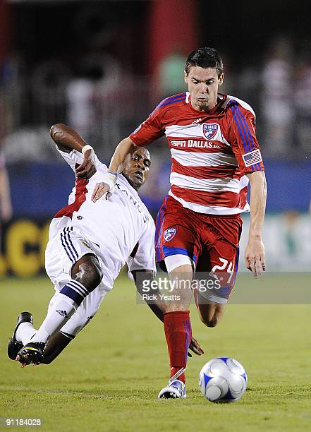 Heath Pearce of the FC Dallas defends the ball from Robbie Findley of Real Salt Lake at Pizza Hut Park on September 26, 2009 in Frisco, Texas.
