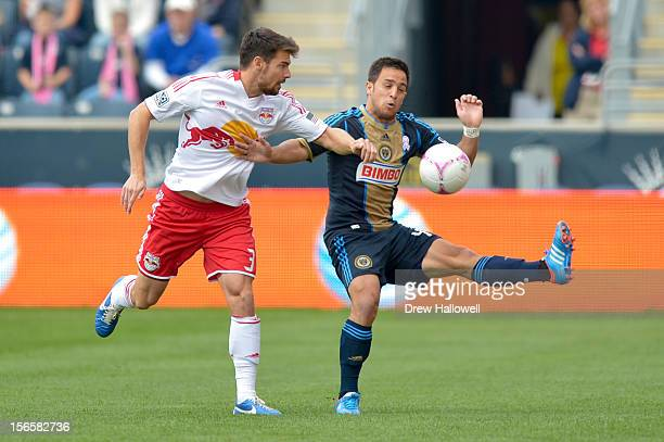 Heath Pearce of the New York Red Bulls and Danny Cruz of the Philadelphia Union go for the ball at PPL Park on October 27, 2012 in Chester,...