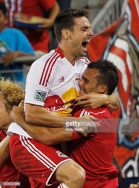 Heath Pearce of the New York Red Bulls celebrates his game winning goal late in the second half with Jonathan Borrajo against the Portland Timbers...