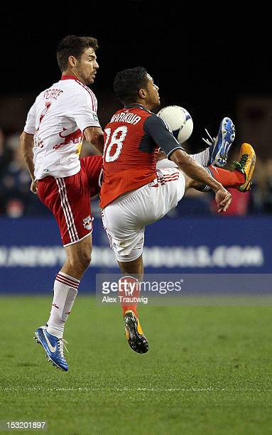 Heath Pearce of the New York Red Bulls defends against Quincey Amarikwa of Toronto FC at Red Bull Arena on September 29, 2012 in Harrison, New Jersey.