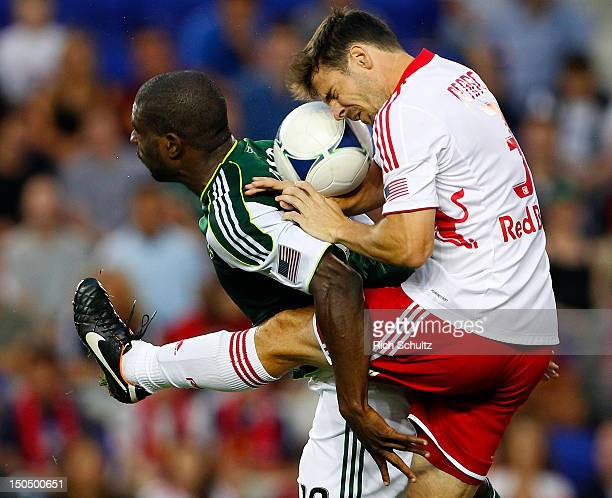 Heath Pearce of the New York Red Bulls heads the ball into the back of Bright Dike of the Portland Timbers during the first half in a Major League...