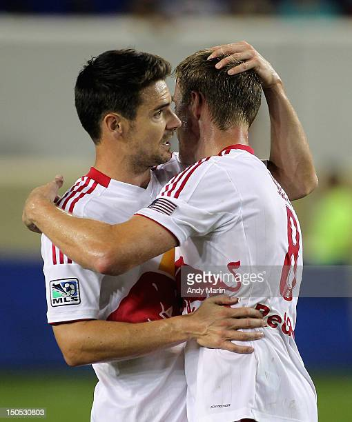 Heath Pearce of the New York Red Bulls is congratulated by Jan Gunnar Solli at games end after Pearce scored the winning goal to defeat the Portland...