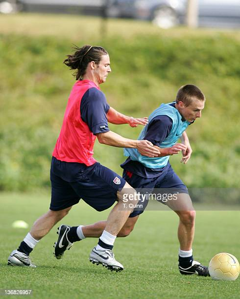 Heath Pearce who plays in Denmark challenges Chris Rolfe of the Chicago Fire at the 2006 USA World Cup team training session on January 22 2006 at...