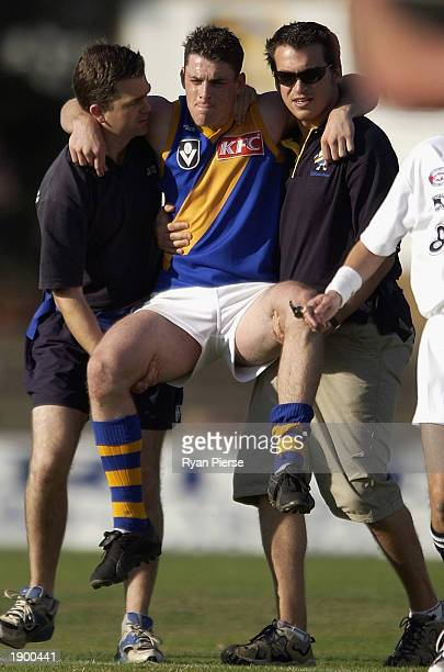 Heath Scotland for Williamstown is carried off after seriously injuring his knee during the VFL match between the Northern Bullants and Williamstown...