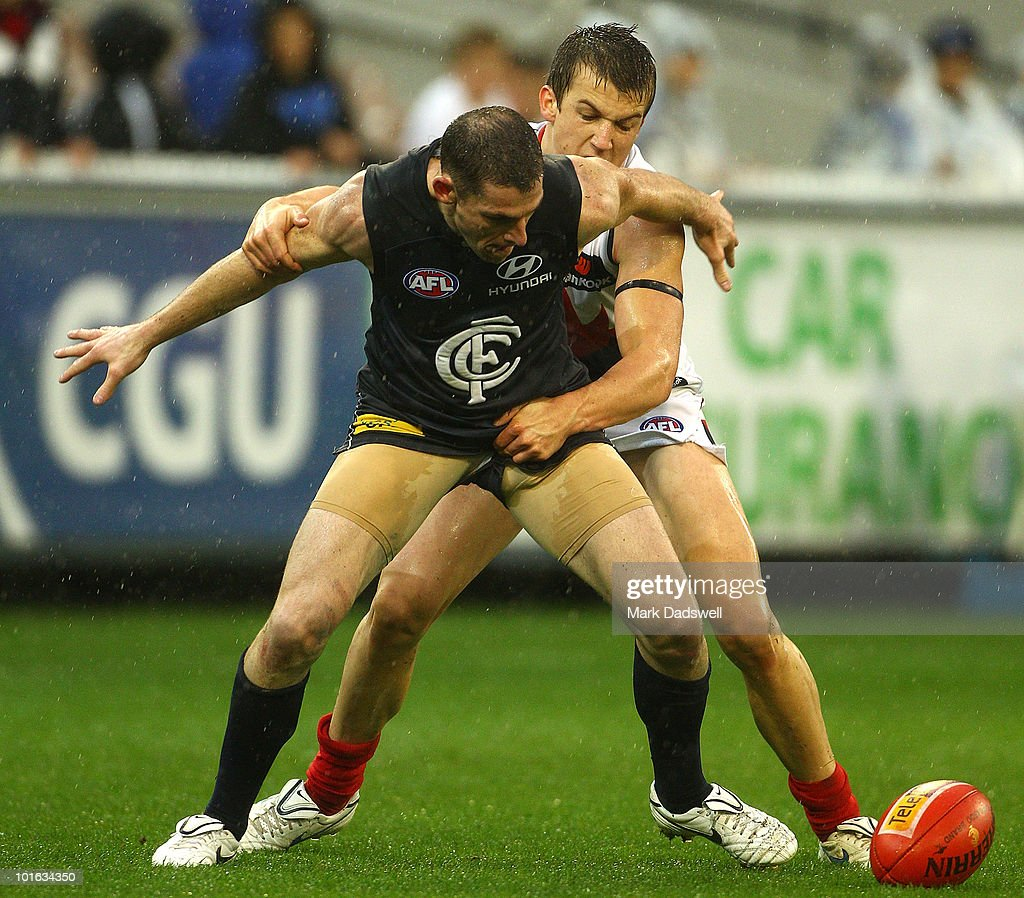 Heath Scotland of the Blues is tackled by Jack Trengove of the Demons during the round 11 AFL match between the Carlton Blues and the Melbourne Demons at Melbourne Cricket Ground on June 5, 2010 in Melbourne, Australia.