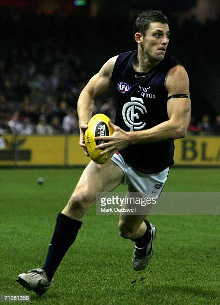 Heath Scotland of the Blues runs the ball downfield during the round 12 AFL match between the Kangaroos and Carlton at the Telstra Dome on June 23...