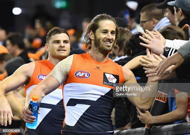 Heath Shaw and Callan Ward of the Giants high five fans after winning the round 21 AFL match between the Western Bulldogs and the Greater Western...