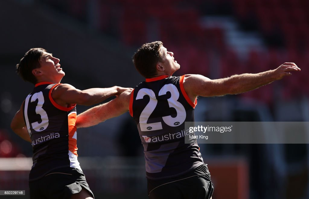 Heath Shaw (R) is challenged by Isaac Cumming (L) during a Greater Western Sydney Giants AFL training session at Spotless Stadium on August 16, 2017 in Sydney, Australia.