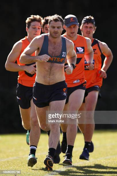 Heath Shaw leads a group of runners as they run a lap during a Greater Western Giants AFL training session at the WestConnex Centre on July 31 2018...