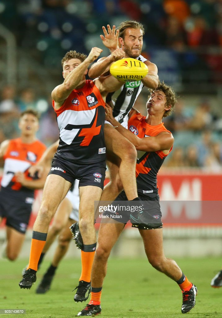 Heath Shaw of the Giants and Tim Broomhead of the Magpies contest possession during the JLT Community Series AFL match between the Greater Western Sydney Giants and the Collingwood Magpies at UNSW Canberra Oval on March 1, 2018 in Canberra, Australia.