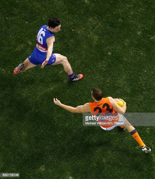 Heath Shaw of the Giants and Toby McLean of the Bulldogs in action during the 2017 AFL round 21 match between the Western Bulldogs and the GWS Giants...