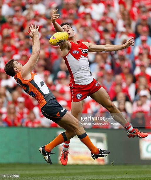 Heath Shaw of the Giants and Xavier Richards of the Swans compete for the ball during the 2016 AFL First Qualifying Final match between the Sydney...