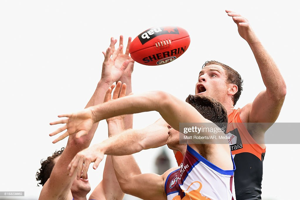 Heath Shaw of the Giants competes for the ball against Jonathan Freeman and Daniel McStay of the Lion during the NAB Challenge AFL match between the Brisbane Lions and the Greater Western Sydney Giants at Metricon Stadium on March 13, 2016 in Gold Coast, Australia.