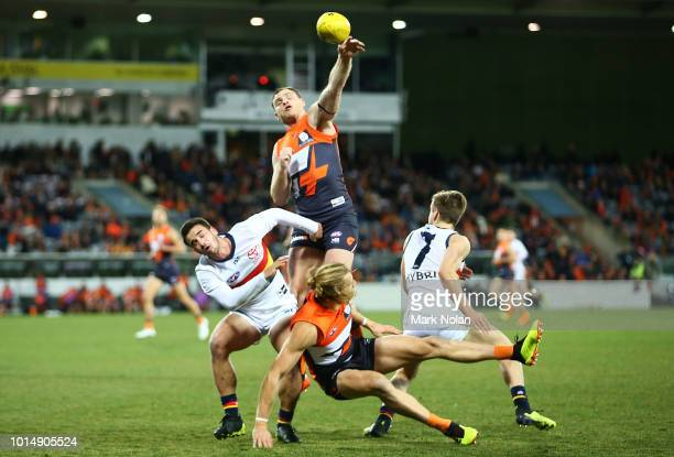 Heath Shaw of the Giants contests possession during the round 21 AFL match between the Greater Western Giants and the Adelaide Crows at UNSW Canberra...