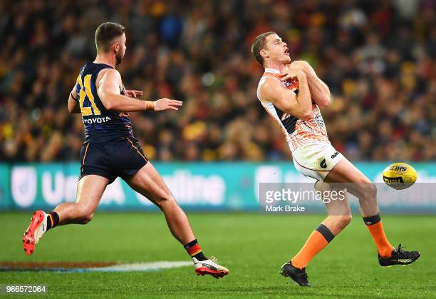 Heath Shaw of the Giants drops an uncontested mark in front of Rory Atkins of the Adelaide Crows during the round 11 AFL match between the Adelaide...