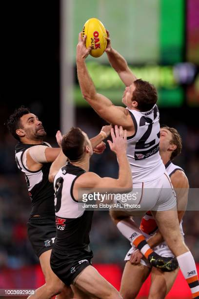 Heath Shaw of the Giants flies during the 2018 AFL round 18 match between the Port Adelaide Power and the GWS Giants at Adelaide Oval on July 22 2018...