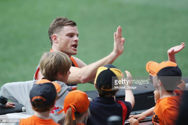 Heath Shaw of the Giants greets a fan during the Greater Western Sydney Giants AFL training session at Melbourne Cricket Ground on September 22 2017...