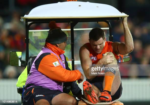 Heath Shaw of the Giants is assisted from the field during the round 21 AFL match between the Greater Western Giants and the Adelaide Crows at UNSW...