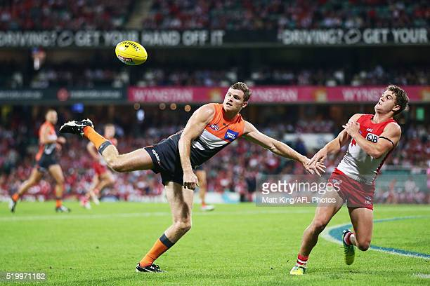 Heath Shaw of the Giants is challenged by Ben McGlynn of the Swans during the round three AFL match between the Sydney Swans and the Greater Western...