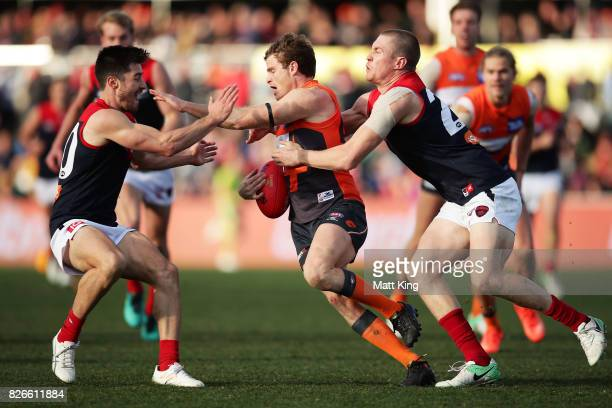 Heath Shaw of the Giants is tackled during the round 20 AFL match between the Greater Western Sydney Giants and the Melbourne Demons at UNSW Canberra...