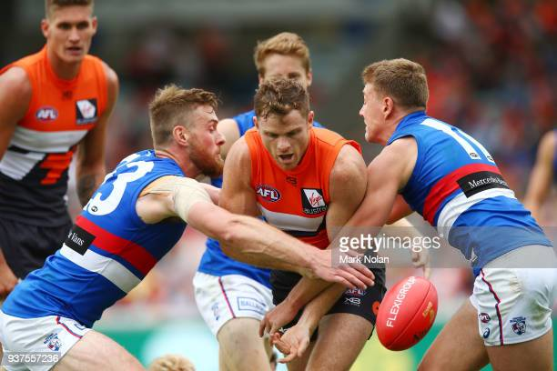 Heath Shaw of the Giants is tackled during the round one AFL match between the Greater Western Sydney Giants and the Western Bulldogs at UNSW...