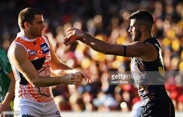 Heath Shaw of the Giants lines and Wayne Milera of the Adelaide Crows front up during the round 11 AFL match between the Adelaide Crows and the...