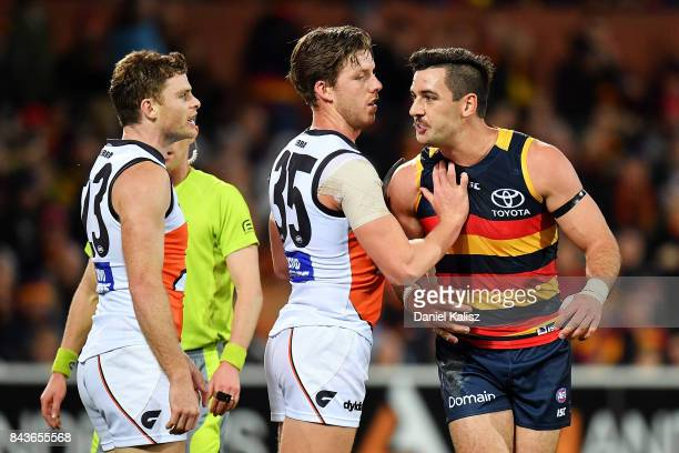 Heath Shaw of the Giants reacts to Taylor Walker of the Crows during the AFL First Qualifying Final match between the Adelaide Crows and the Greater...