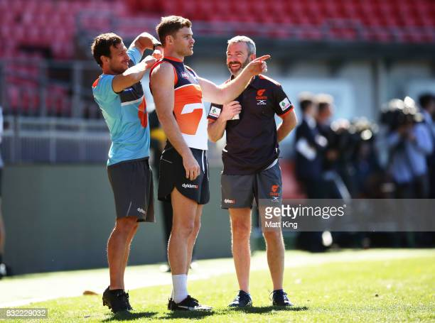 Heath Shaw of the Giants talks to coaching staff during a Greater Western Sydney Giants AFL training session at Spotless Stadium on August 16 2017 in...