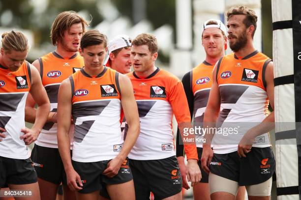 Heath Shaw of the Giants talks to Isaac Cumming of the Giants during a Greater Western Sydney Giants AFL training session at WestConnex Centre on...