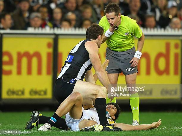 Heath Shaw of the Magpies gives away a free kick to Angus Monfries of the Power during the Second AFL Elimination Final match between the Collingwood...