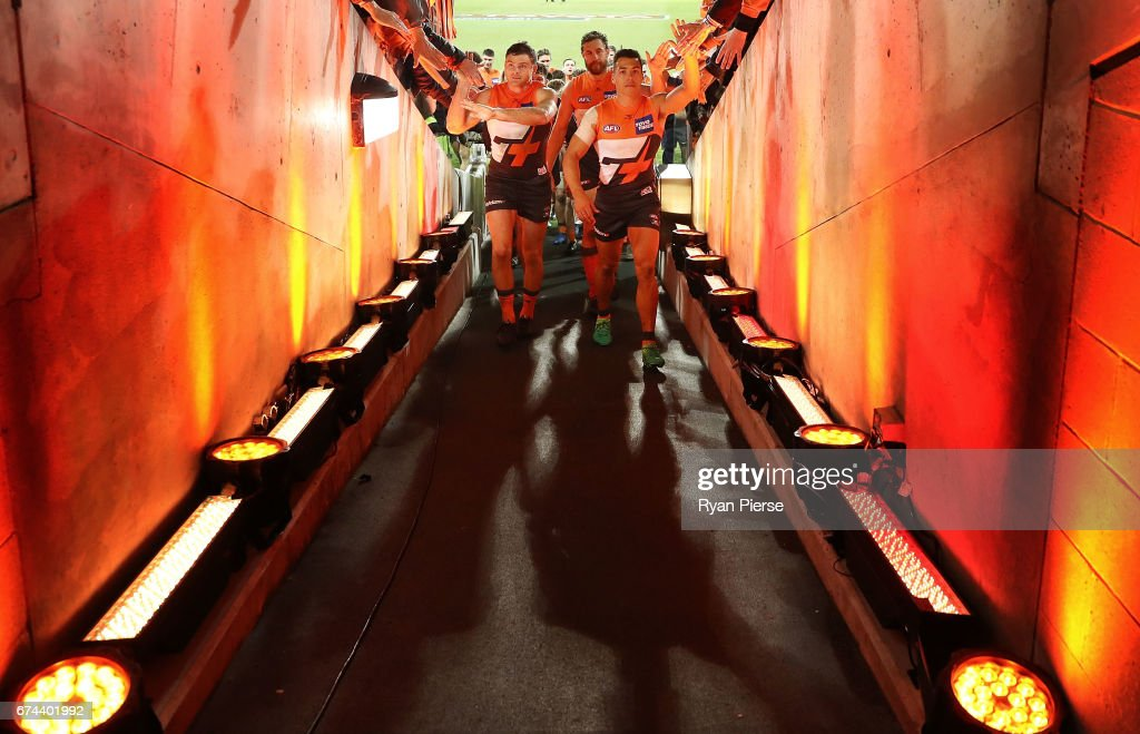 Heath Shaw, Shane Mumford and Dylan Shiel of the Giants lead their team from the ground after the round six AFL match between the Greater Western Sydney Giants and the Western Bulldogs at UNSW Canberra Oval on April 28, 2017 in Canberra, Australia.