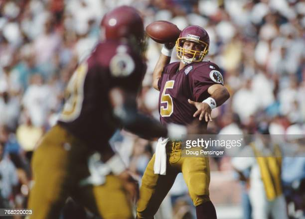 Heath Shuler Quarterback for the Washington Redskins prepares to pass the ball to Tight End Ethan Horton during the National Football Conference East...