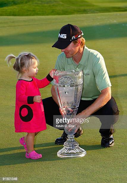 Heath Slocum and his daughter Stella pose with the championship trophy after Heath won The Barclays on August 30, 2009 at Liberty National in Jersey...