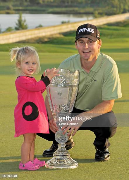 Heath Slocum and his daughter Stella pose with the tournament trophy after winning the The Barclays at Liberty National Golf Club on August 30 2009...