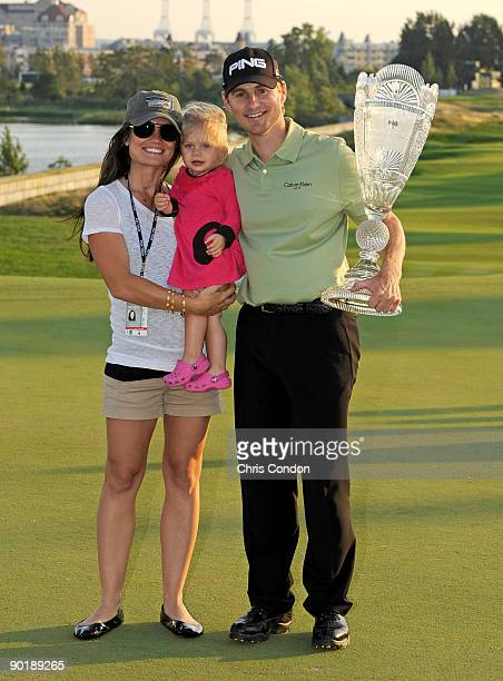 Heath Slocum his wife Victoria and his daughter Stella pose with the tournament trophy after winning the The Barclays at Liberty National Golf Club...
