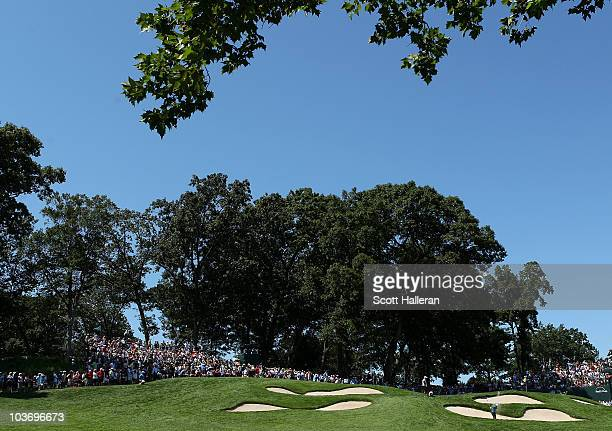 Heath Slocum hits a shot out of the bunker onto to the fifth hole green during the third round of The Barclays at the Ridgewood Country Club on...