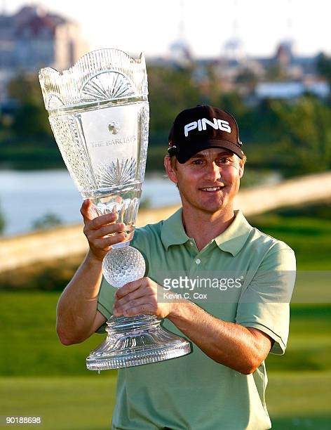 Heath Slocum poses with the championship trophy after winning The Barclays on August 30 2009 at Liberty National in Jersey City New Jersey